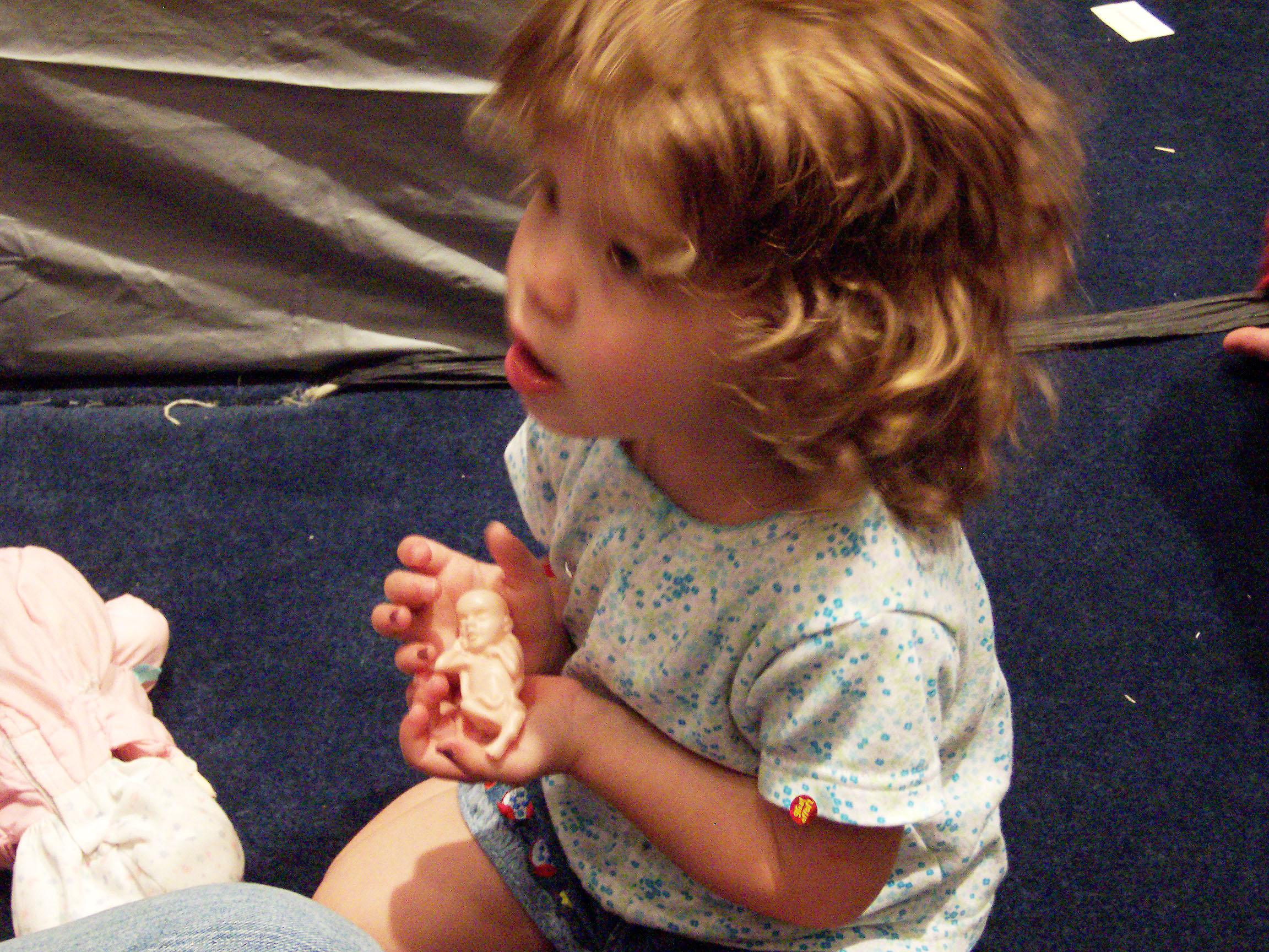 preschooler with plastic fetus